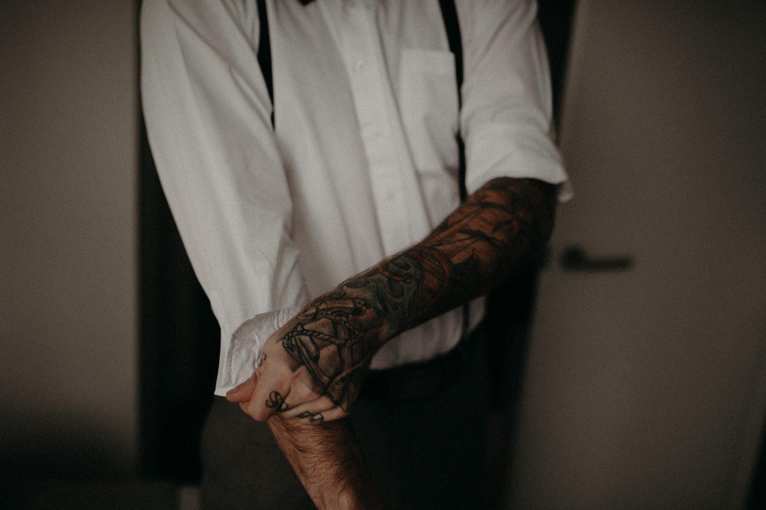 tattooed groom sleeves