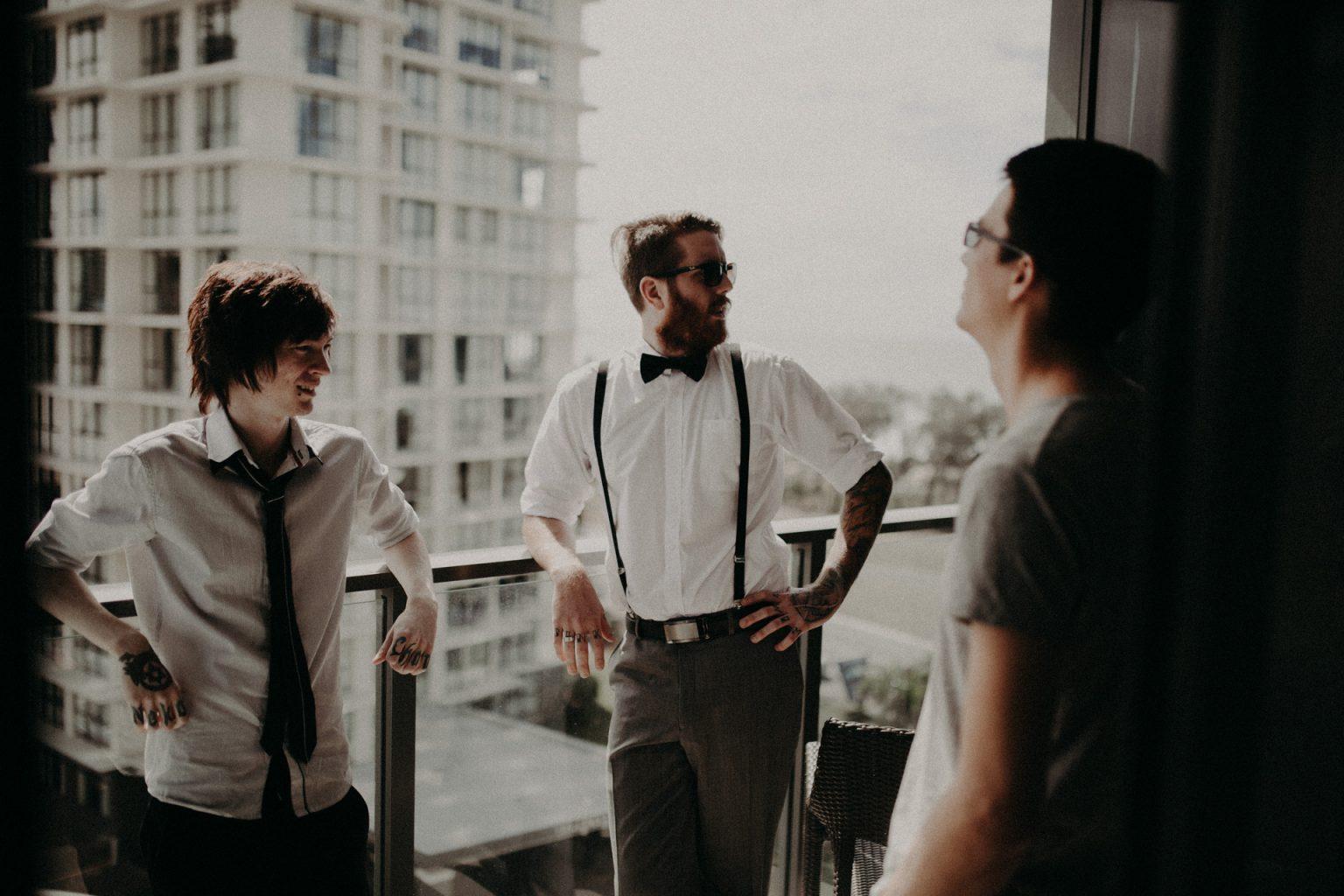 groomsmen on balcony