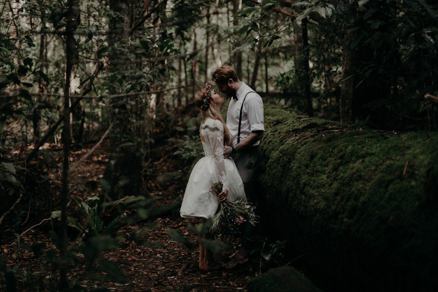 bride groom forest kiss moss tree trunk