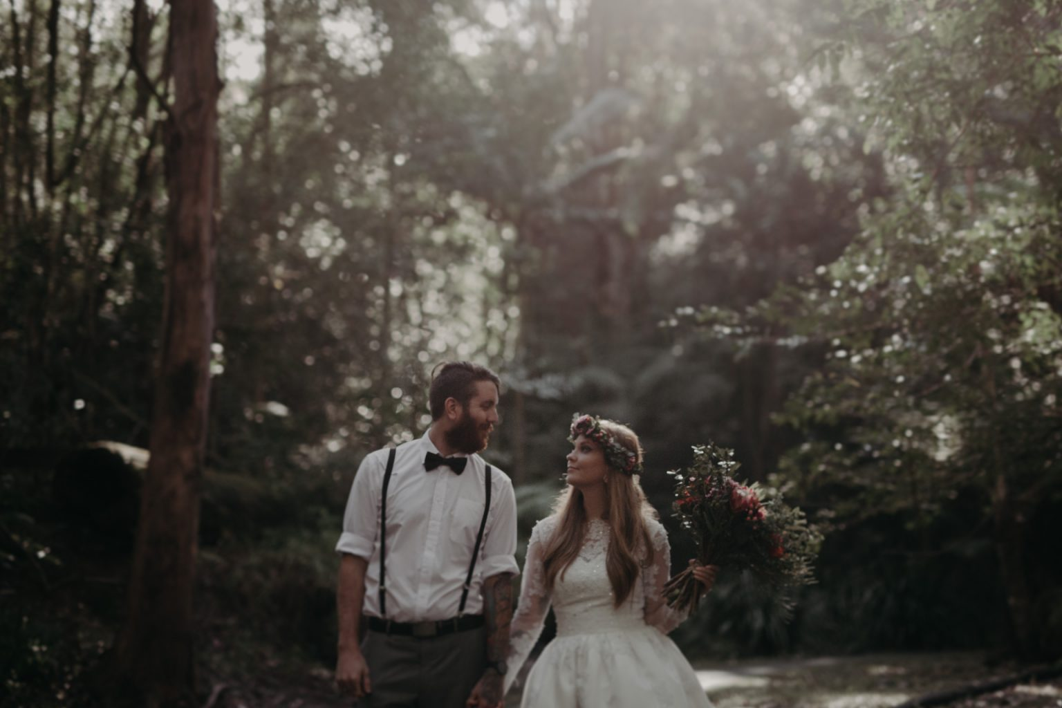 bride groom happy on forest path
