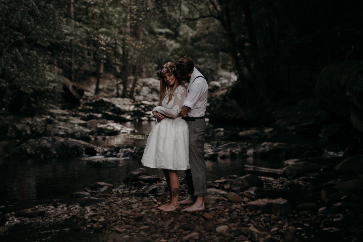 bride groom hug in forest cougal cascades currumbin
