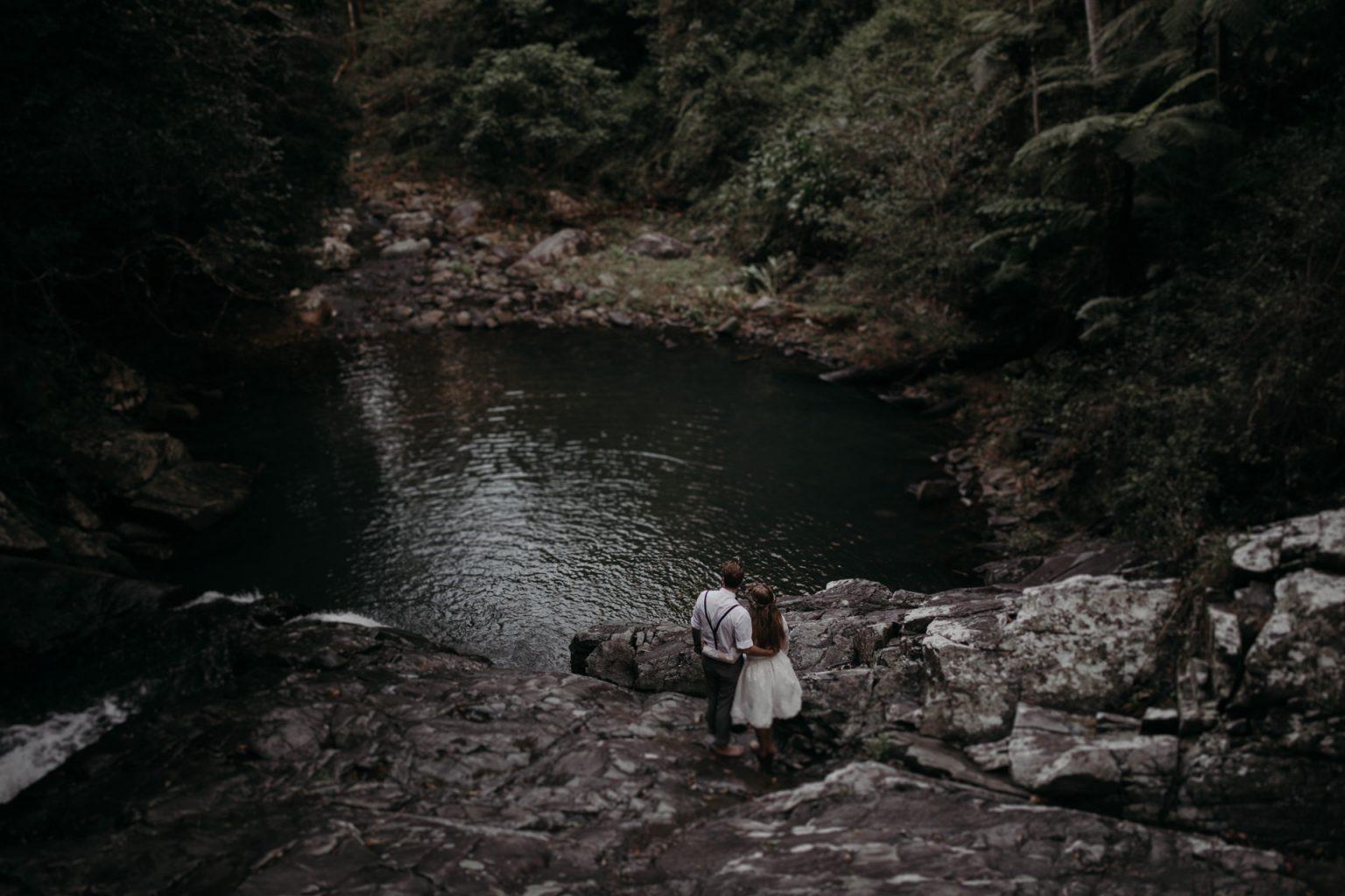 bride groom rocks pool in forest cougal cascades currumbin
