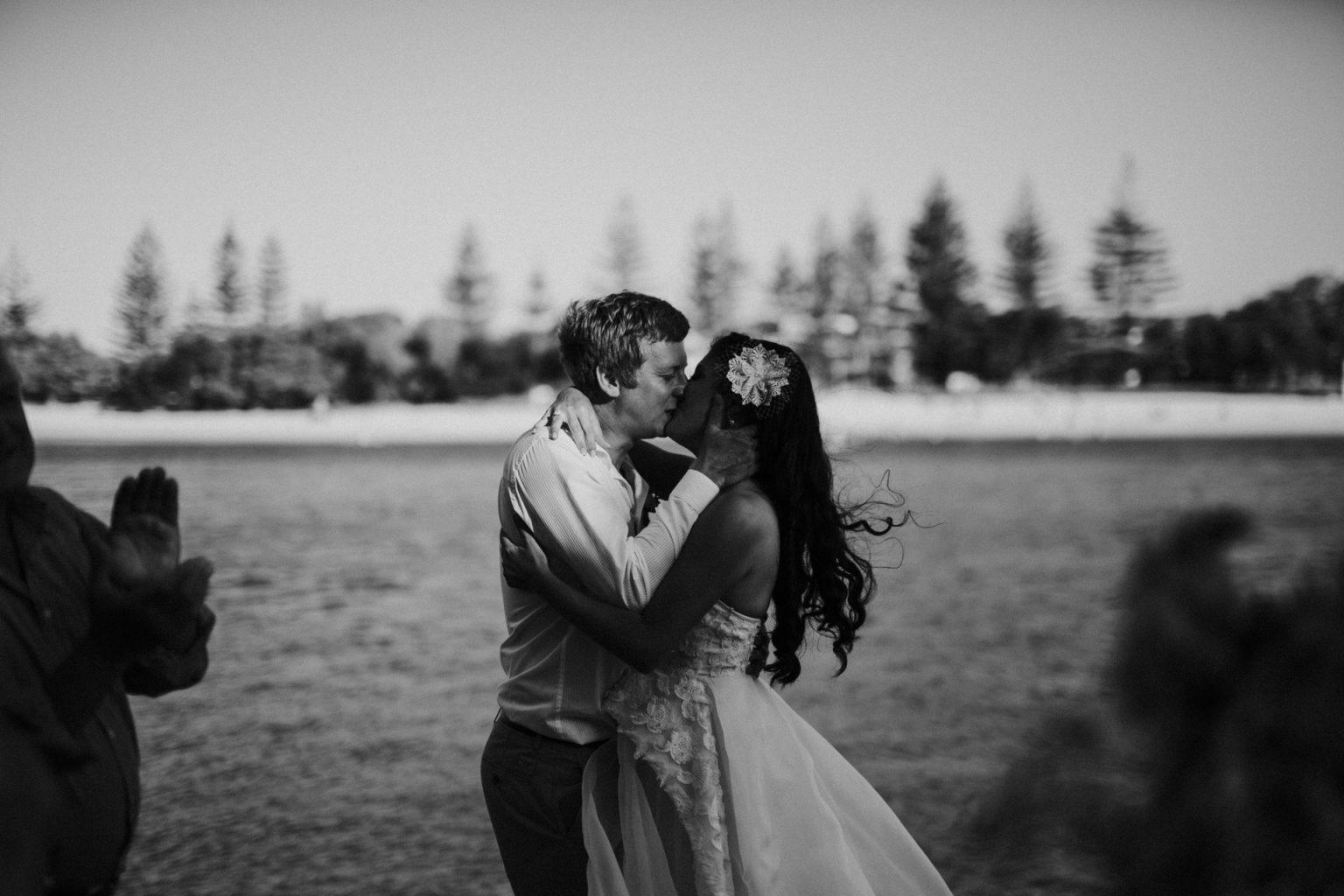 bride and groom kiss echo beach burleigh