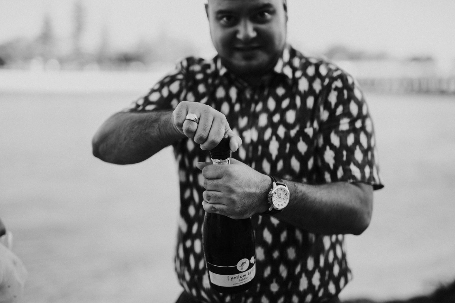 man opening champagne