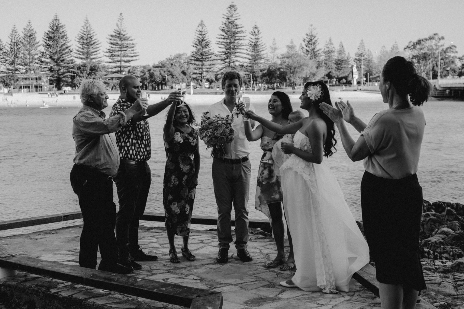 family toasting bridal party with champagne