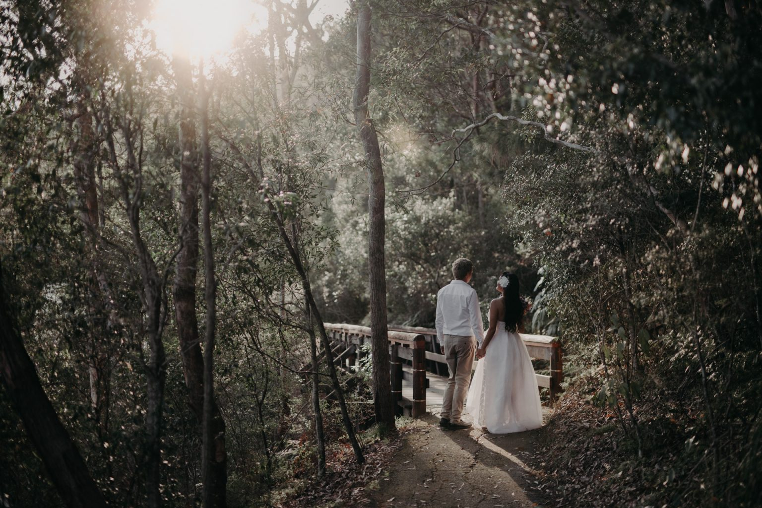 bride and groom walking through forest burleigh headland