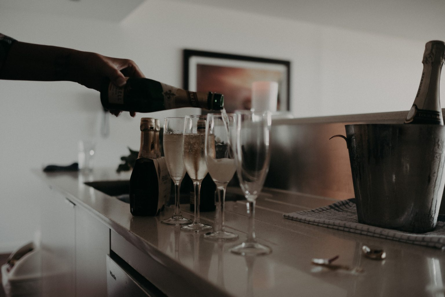hand pouring champagne