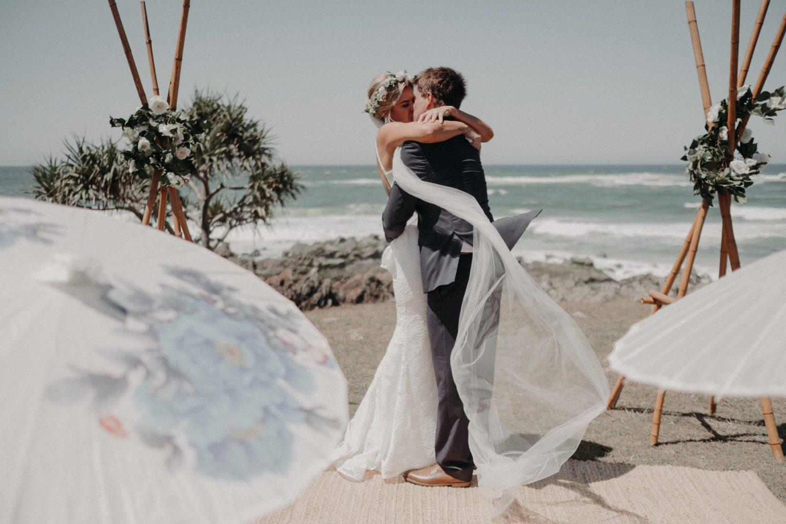 bride groom cliffside wedding ceremony kiss