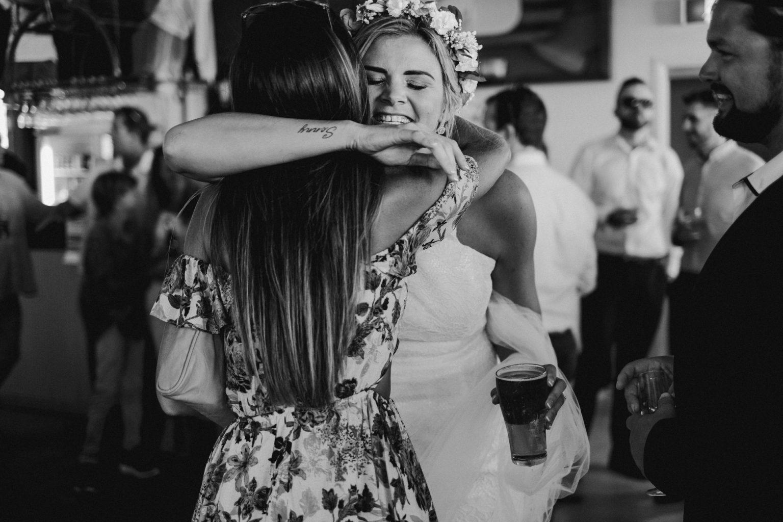 bride groom reception  emotion hug