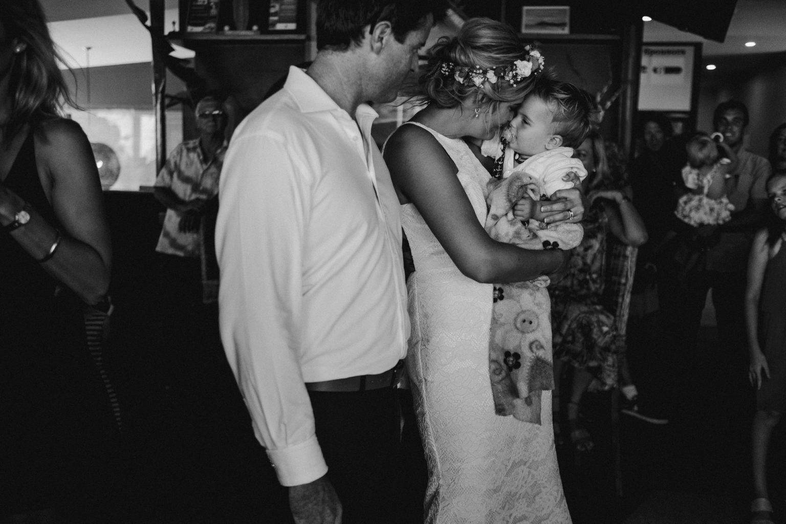 bride groom reception hug baby