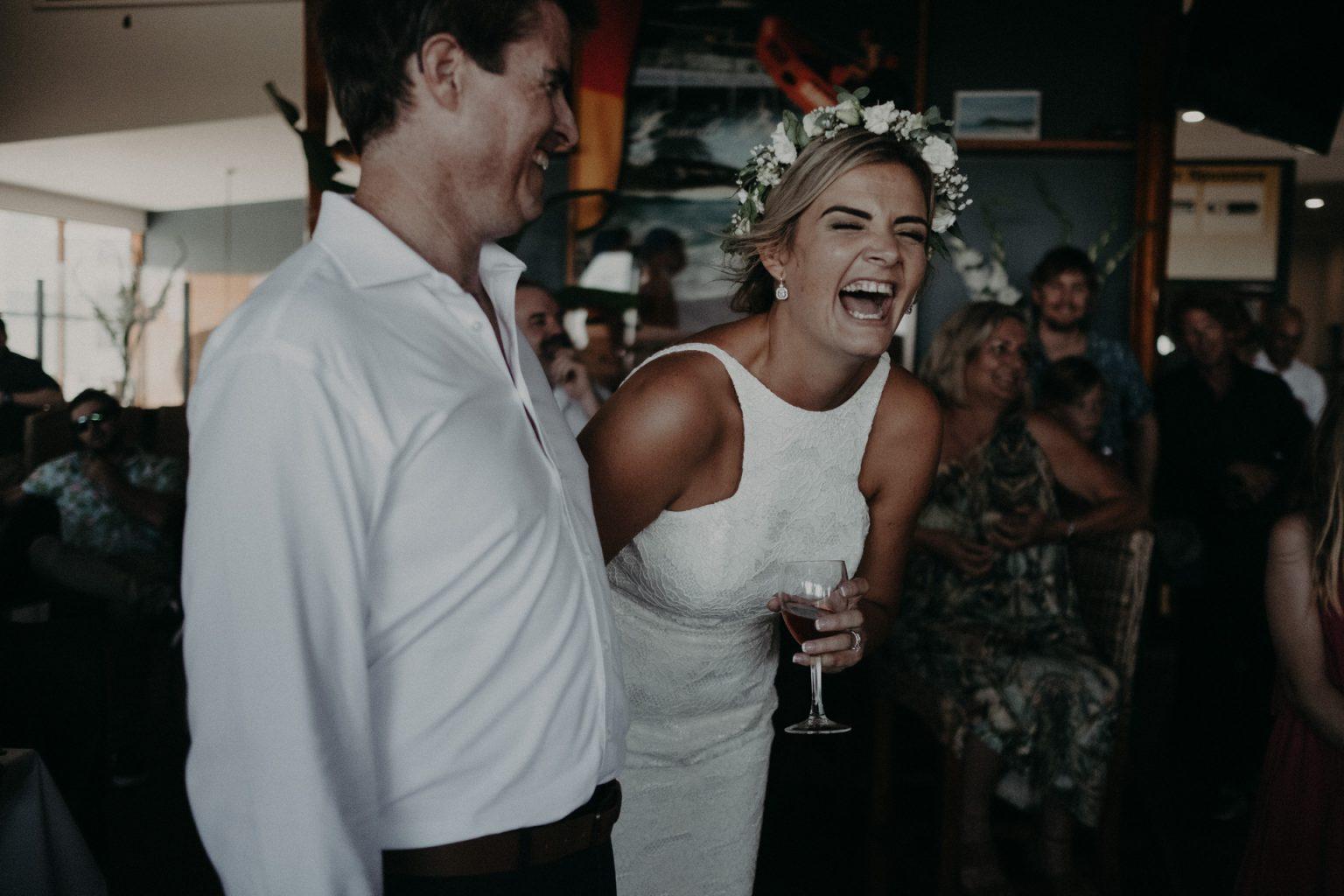 bride groom reception laughing