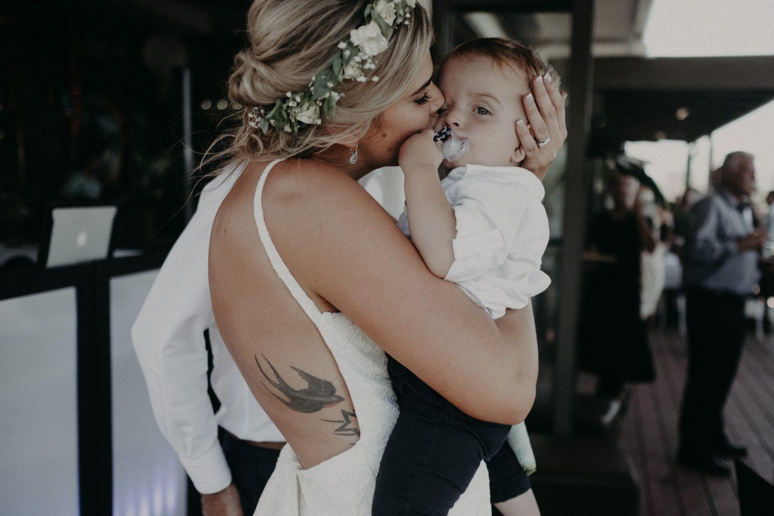 bride reception kiss baby