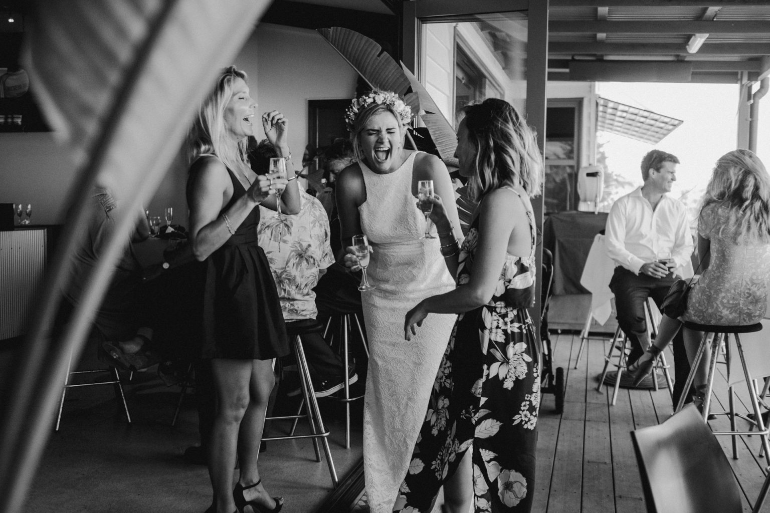 bride reception laughing