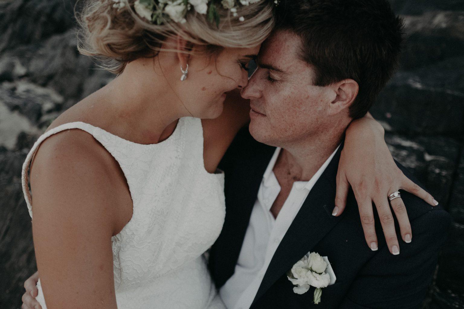 bride and groom cabaret beach kiss
