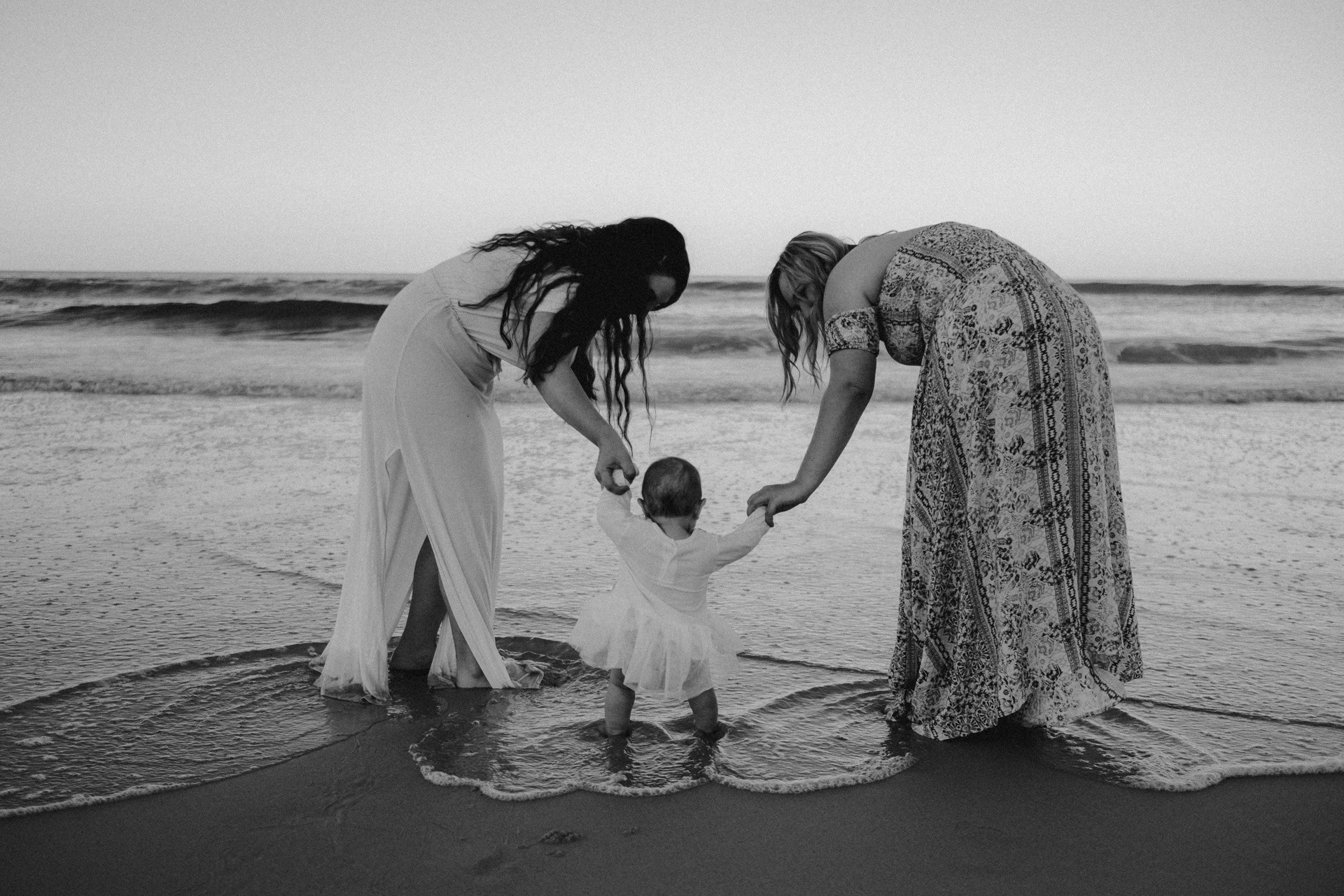 mother and baby on beach