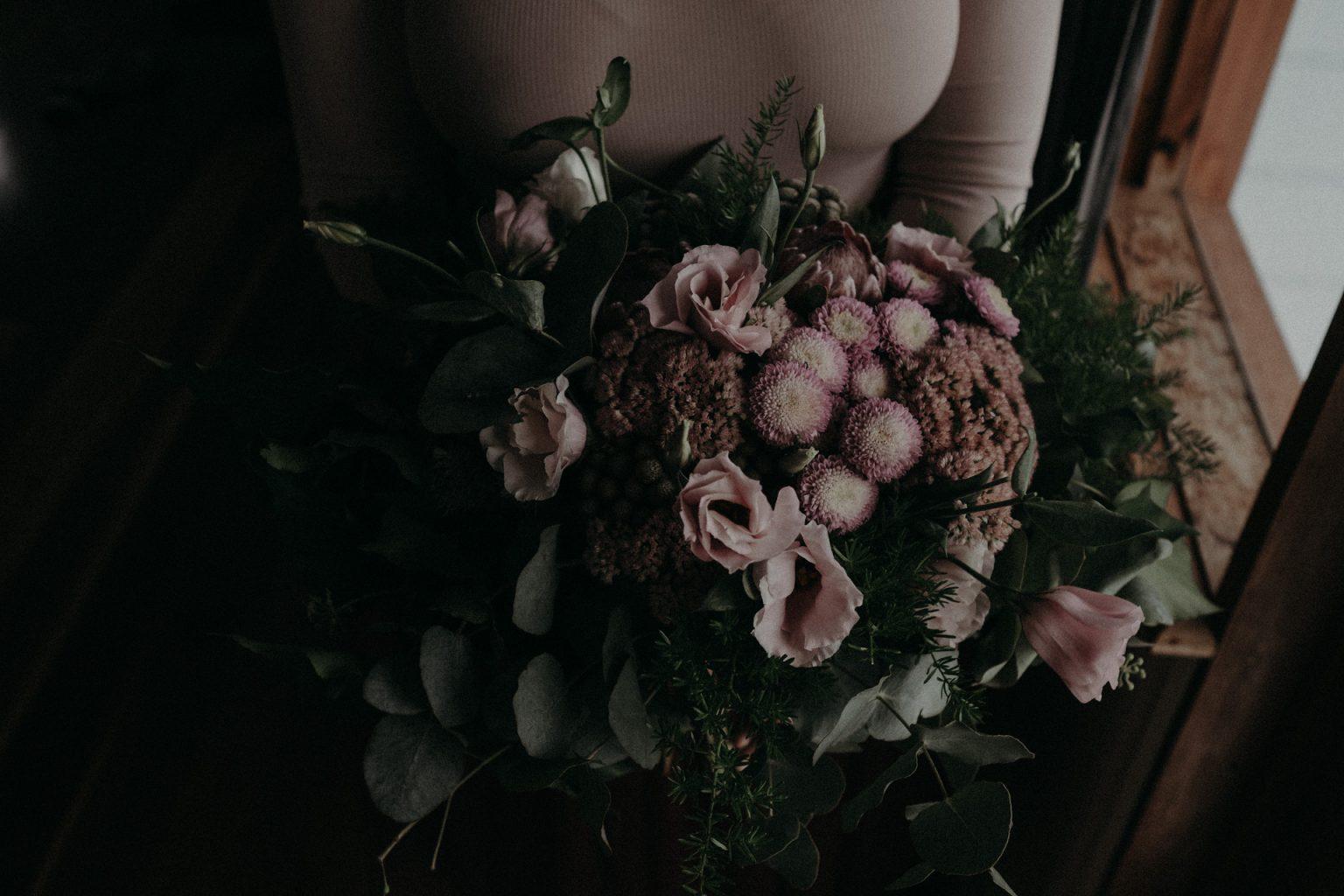 bride pink dress flowers by window