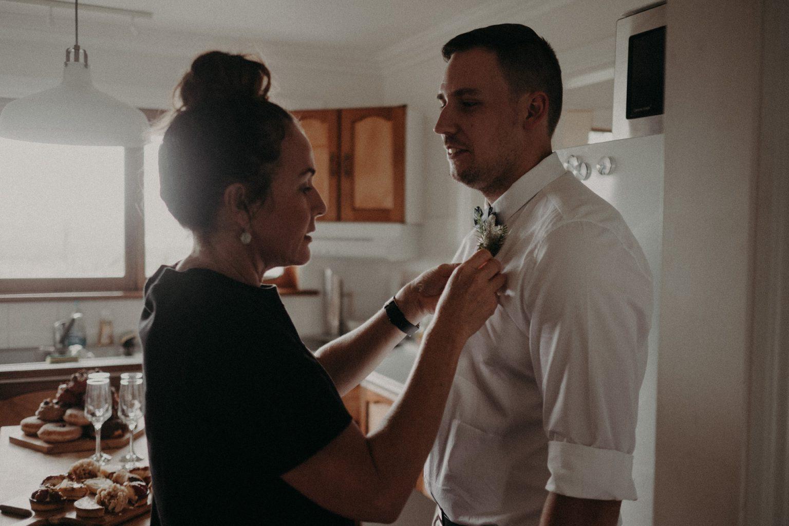 celebrant fixing groom's tie
