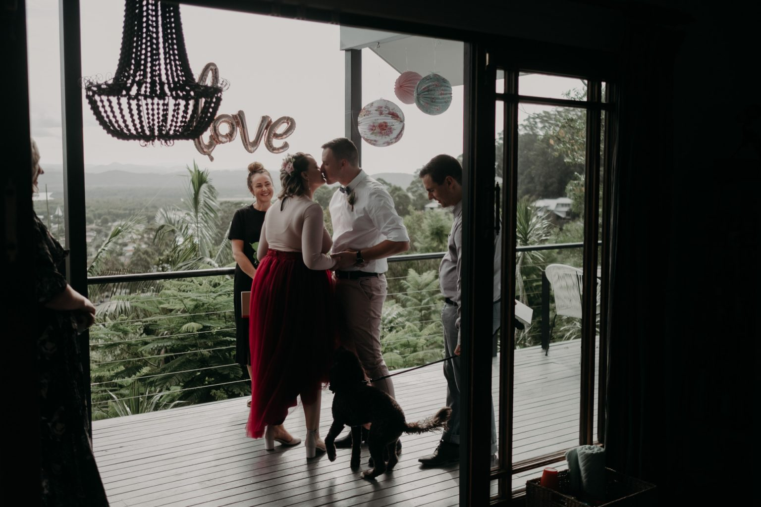 bride and groom on back deck private elopement