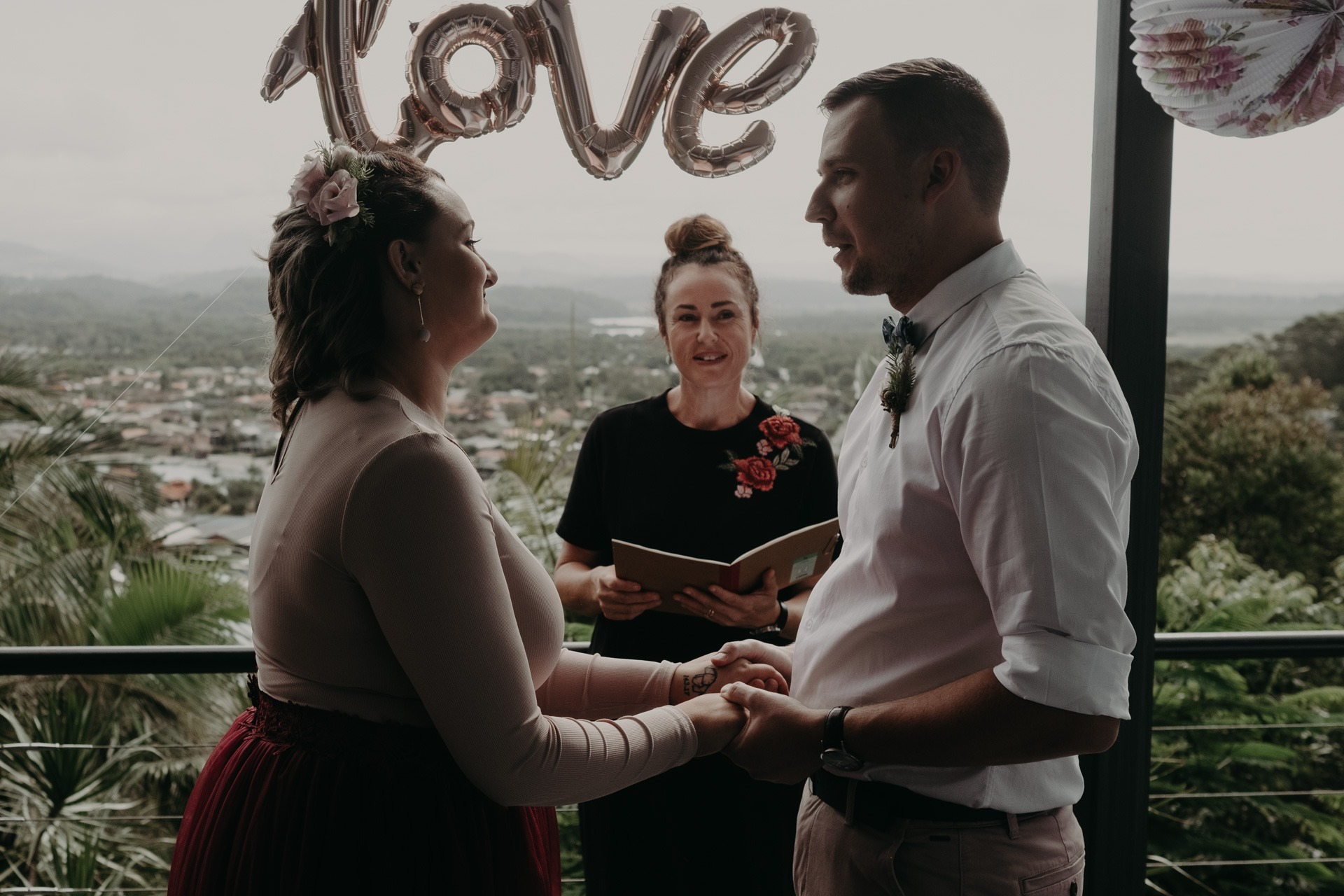 bride and groom on back deck private elopement vows