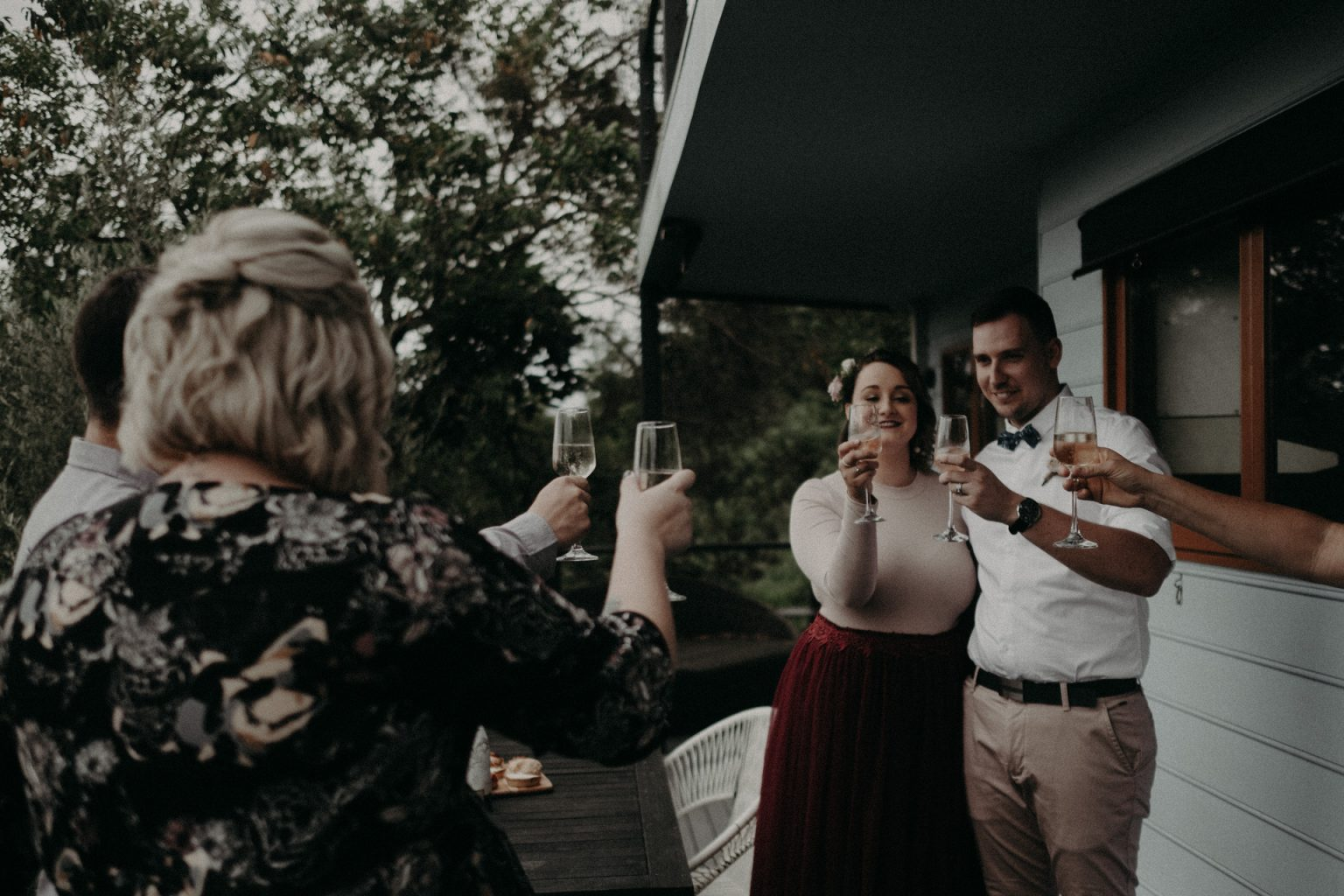 bridal party toasting with wine