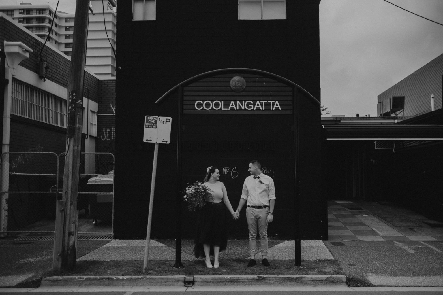 bride and groom by Coolangatta sign