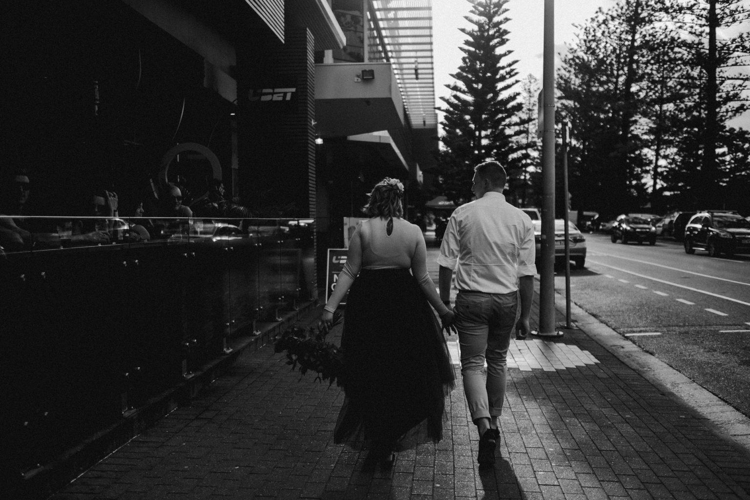bride and groom walking down street of Coolangatta
