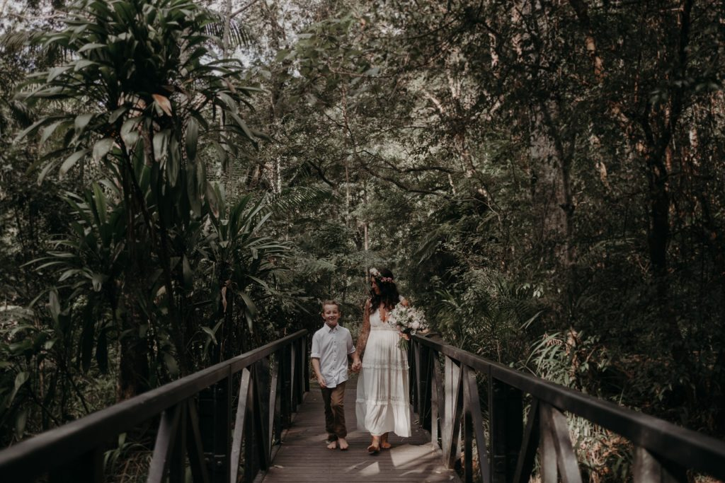 bride walking in forest