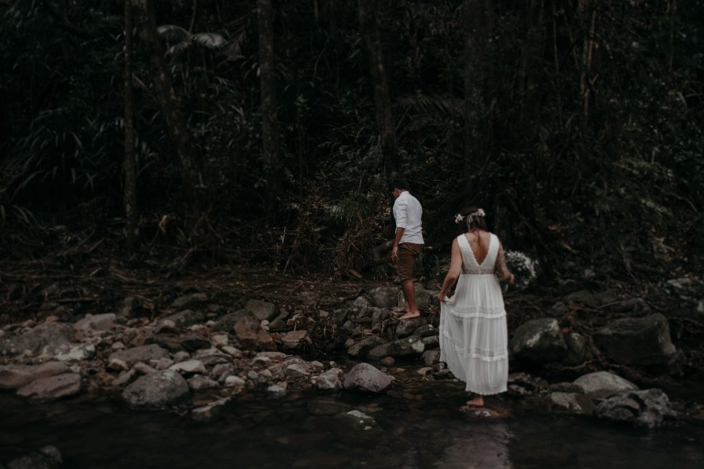 bride and groom walking in forest cougar cascades currumbin