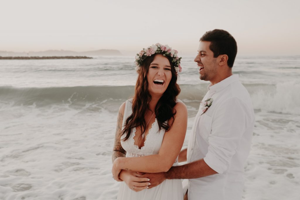 bride and groom standing in ocean flower crown sunset Currumbin gold coast