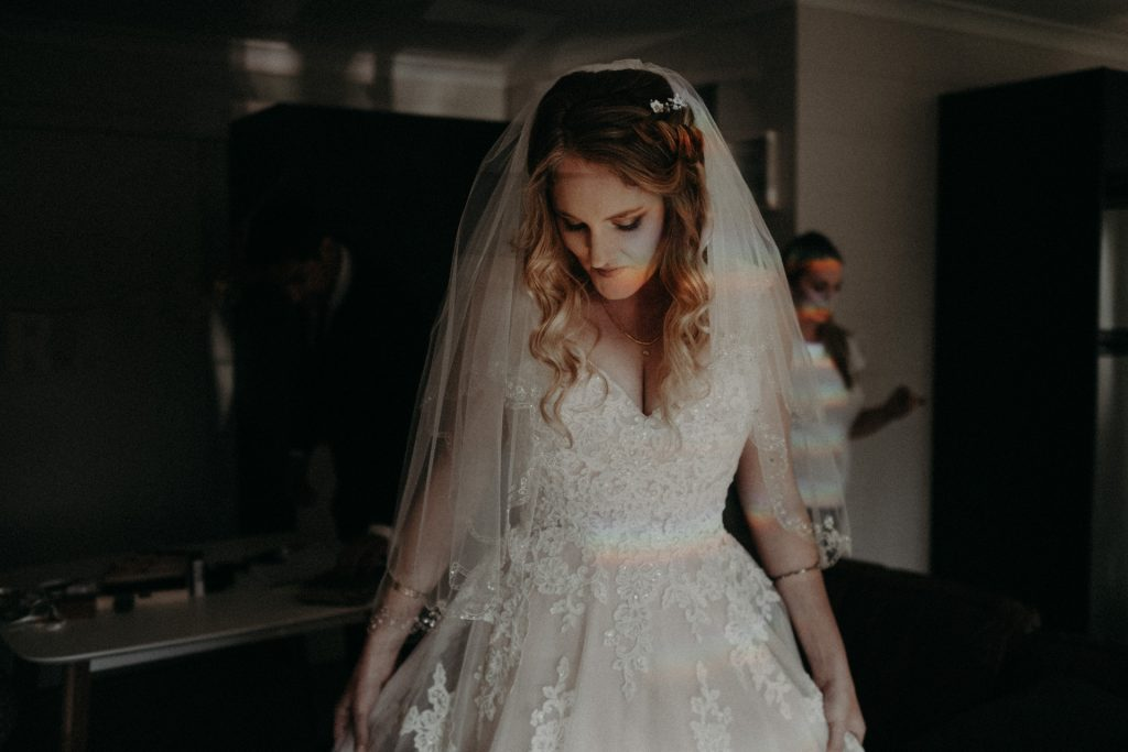 bride wearing dress with rainbow on  skin