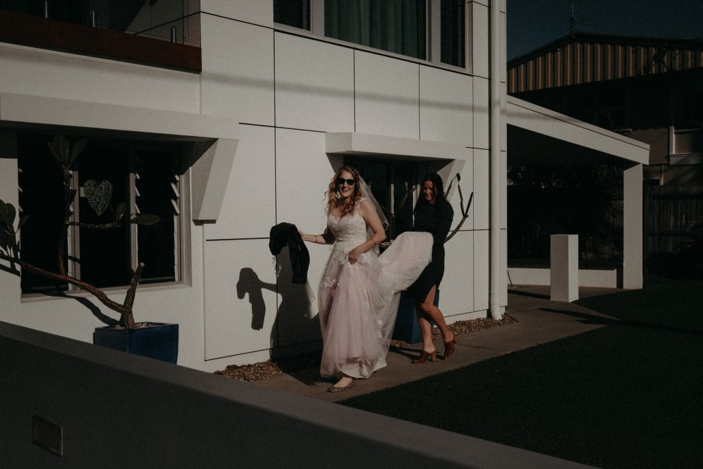 bride in pink dress and sunglasses