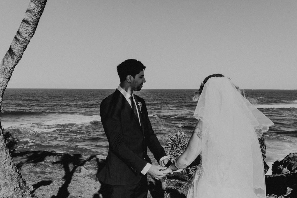 groom at ceremony on cliff