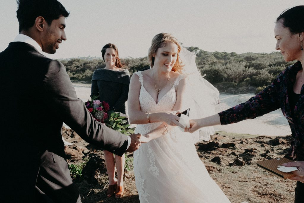 ceremony on windy cliff Fingal head bride in pink dress