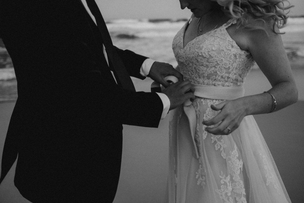 bride and groom martial arts white belt beach