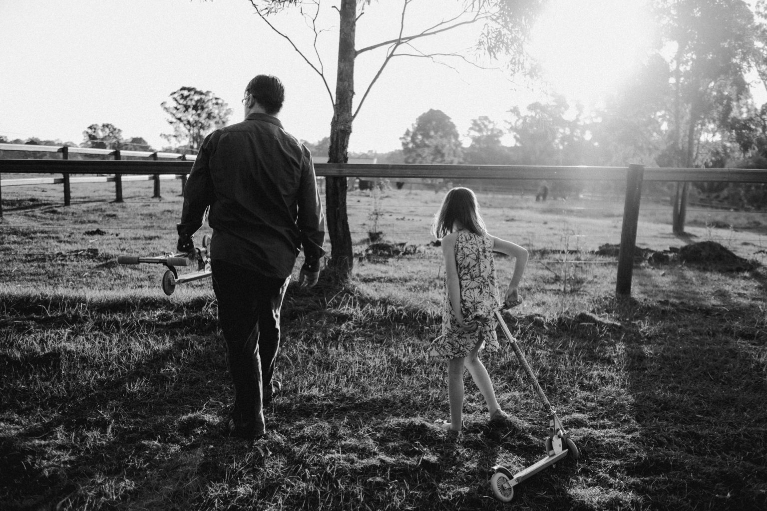 girl and father in paddock