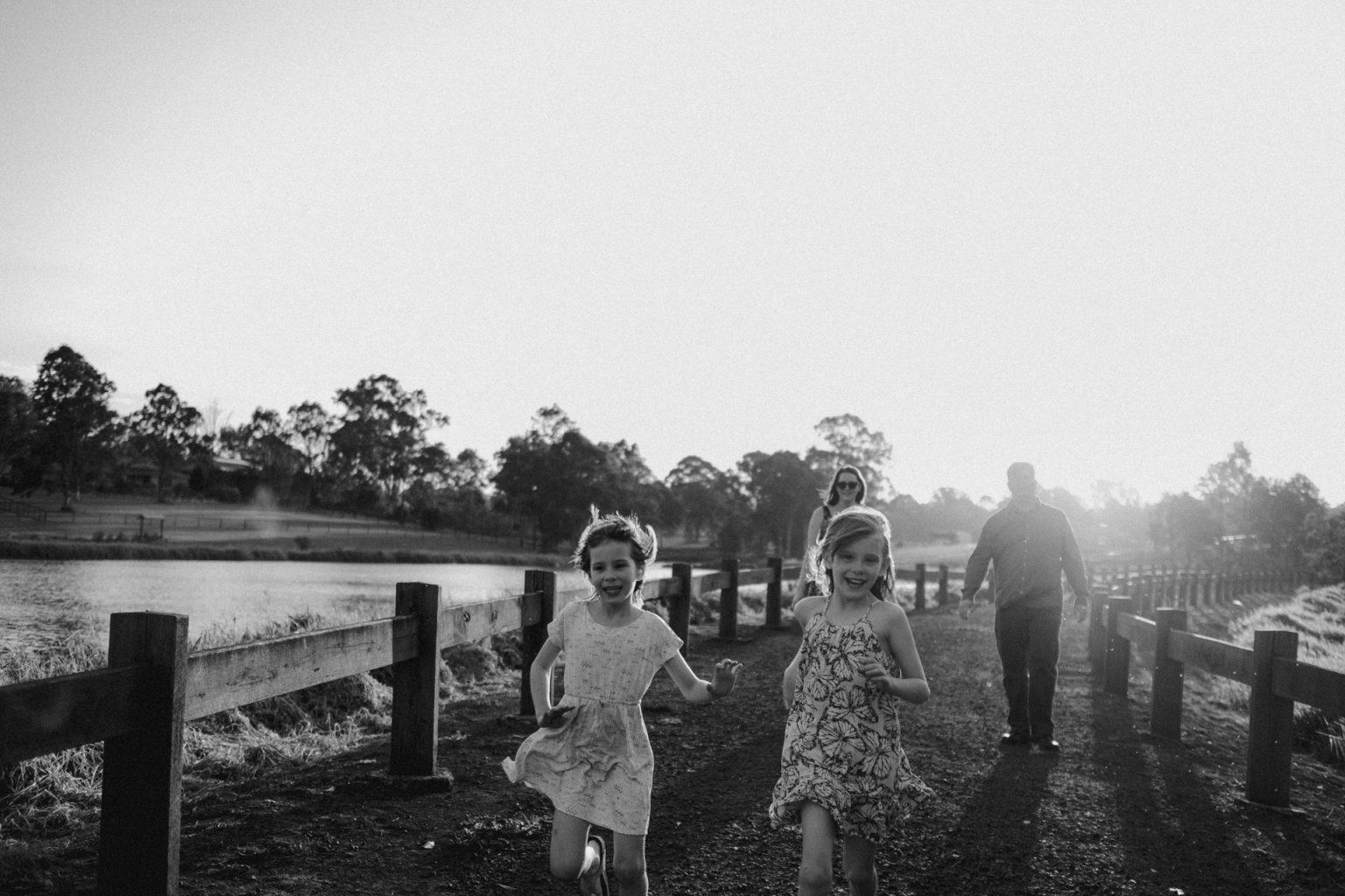 twin girls running towards camera