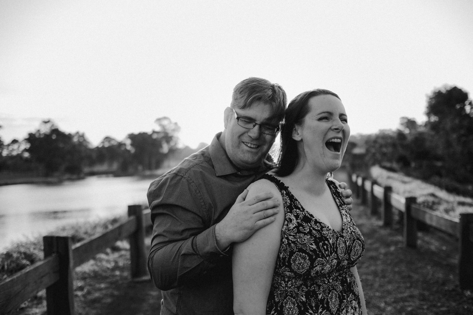 man and woman laughing in photo shoot