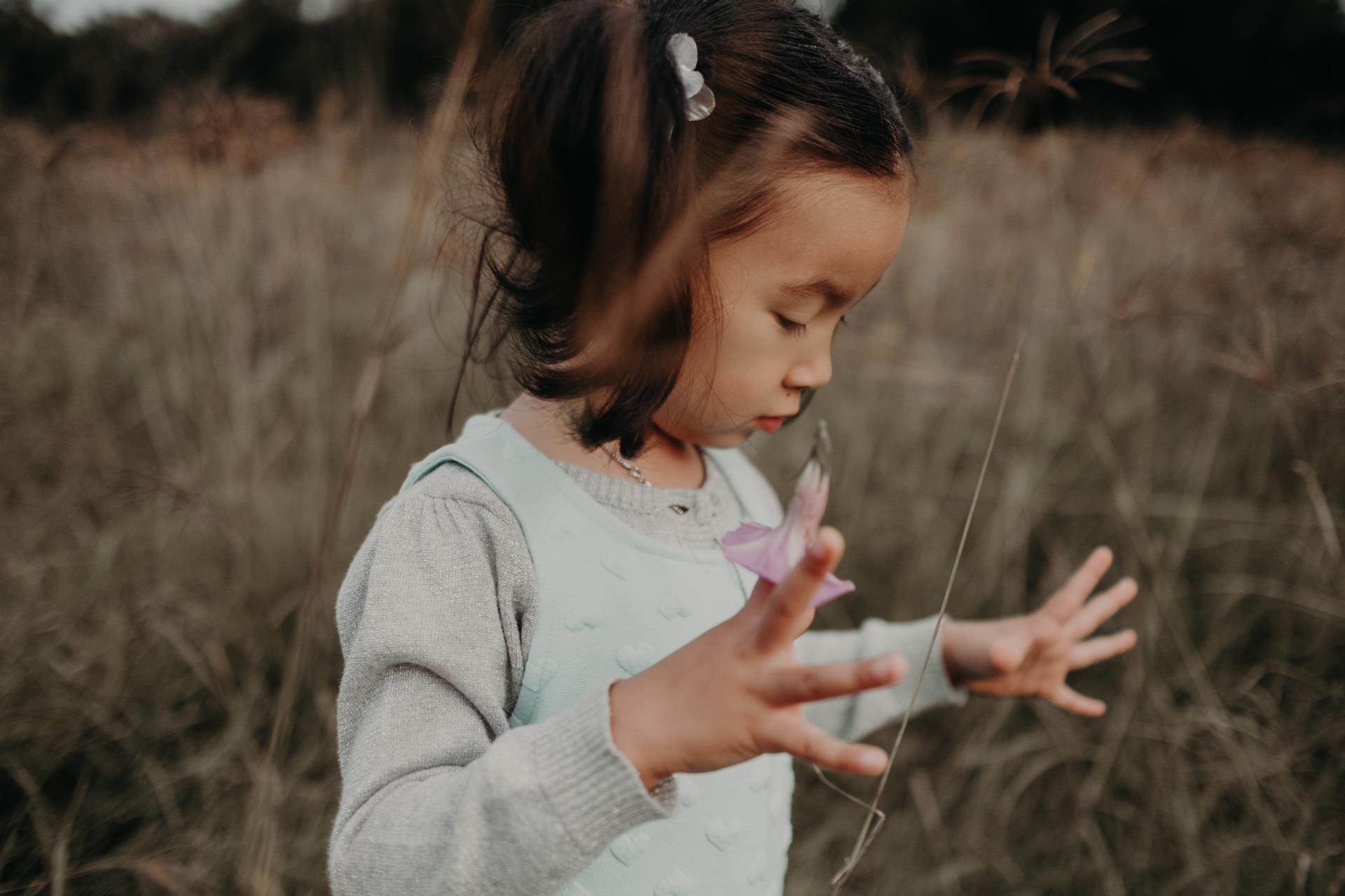 girl playing long grass mt tamborine family