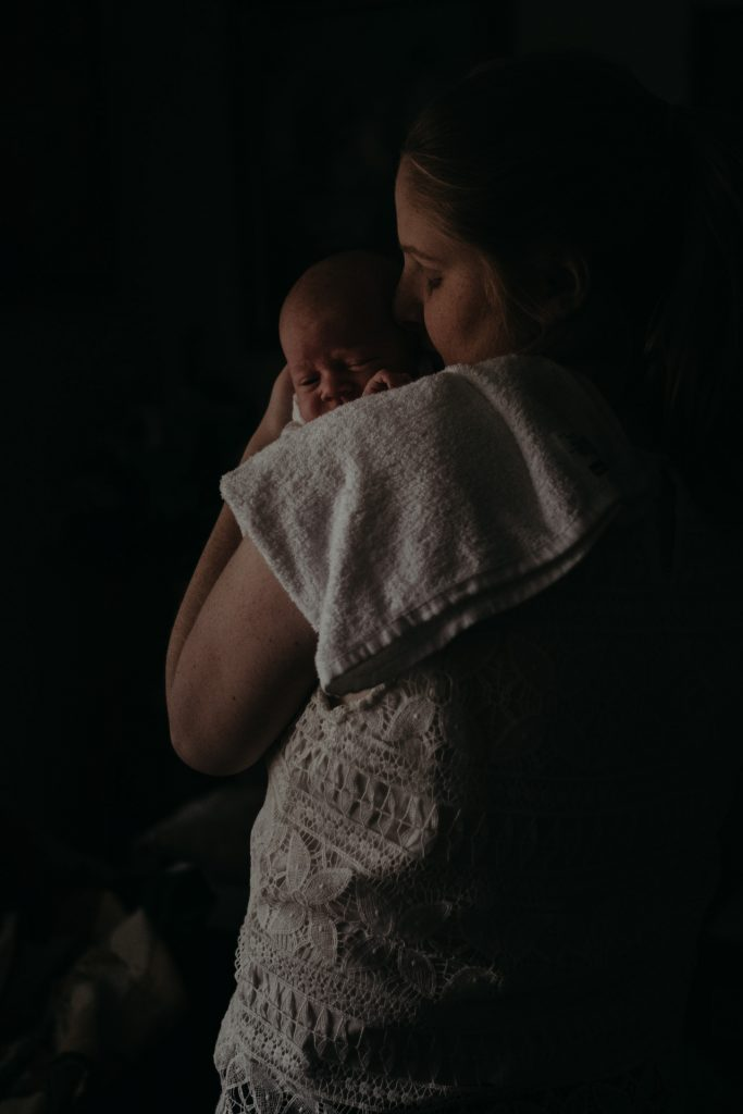woman holding newborn