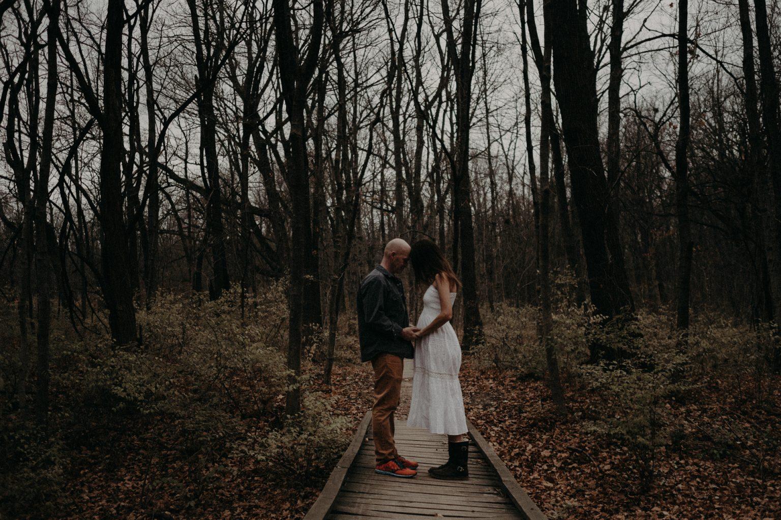 man pregnant woman woods forest illinois bridge