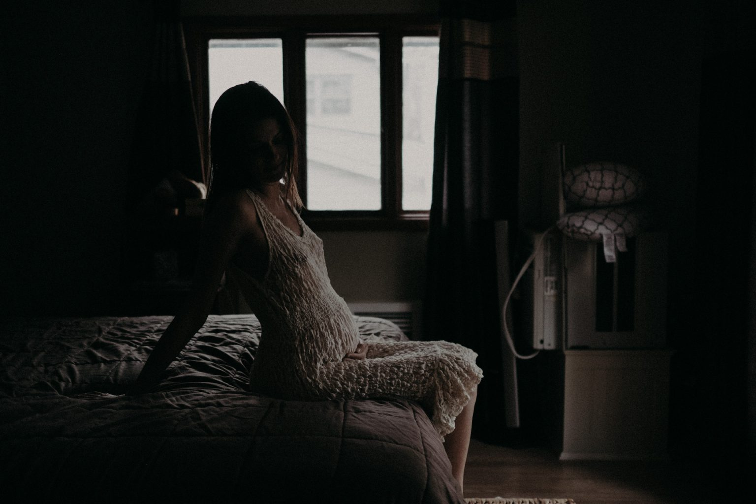 pregnant woman in lace by window