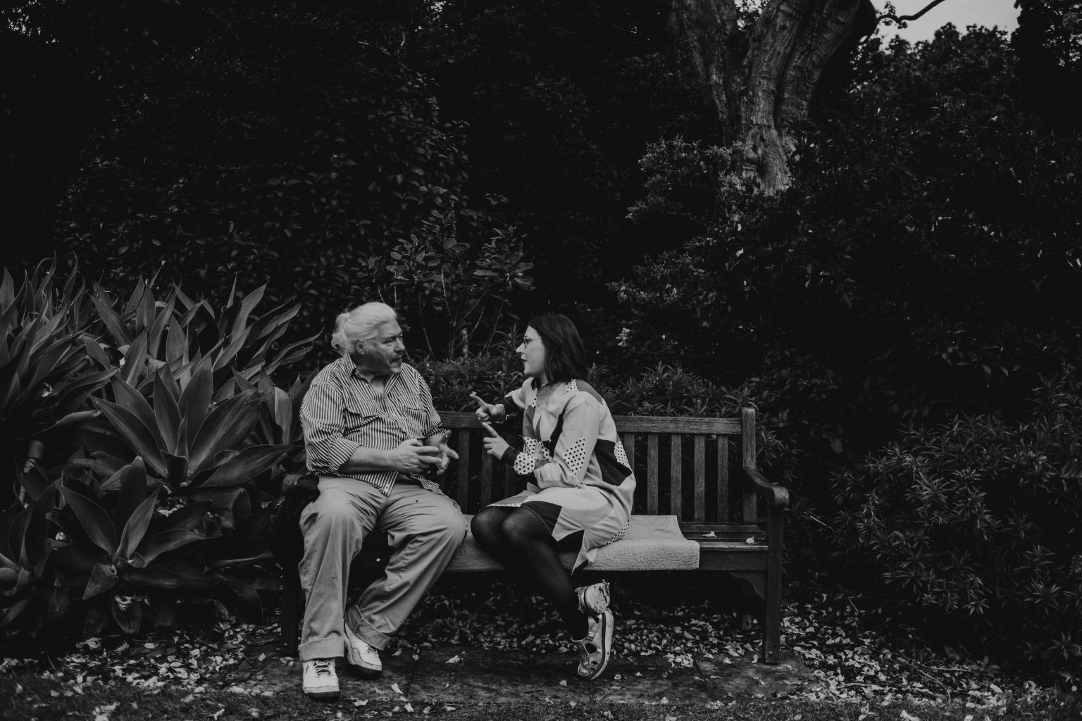 woman talking to father park bench sydney