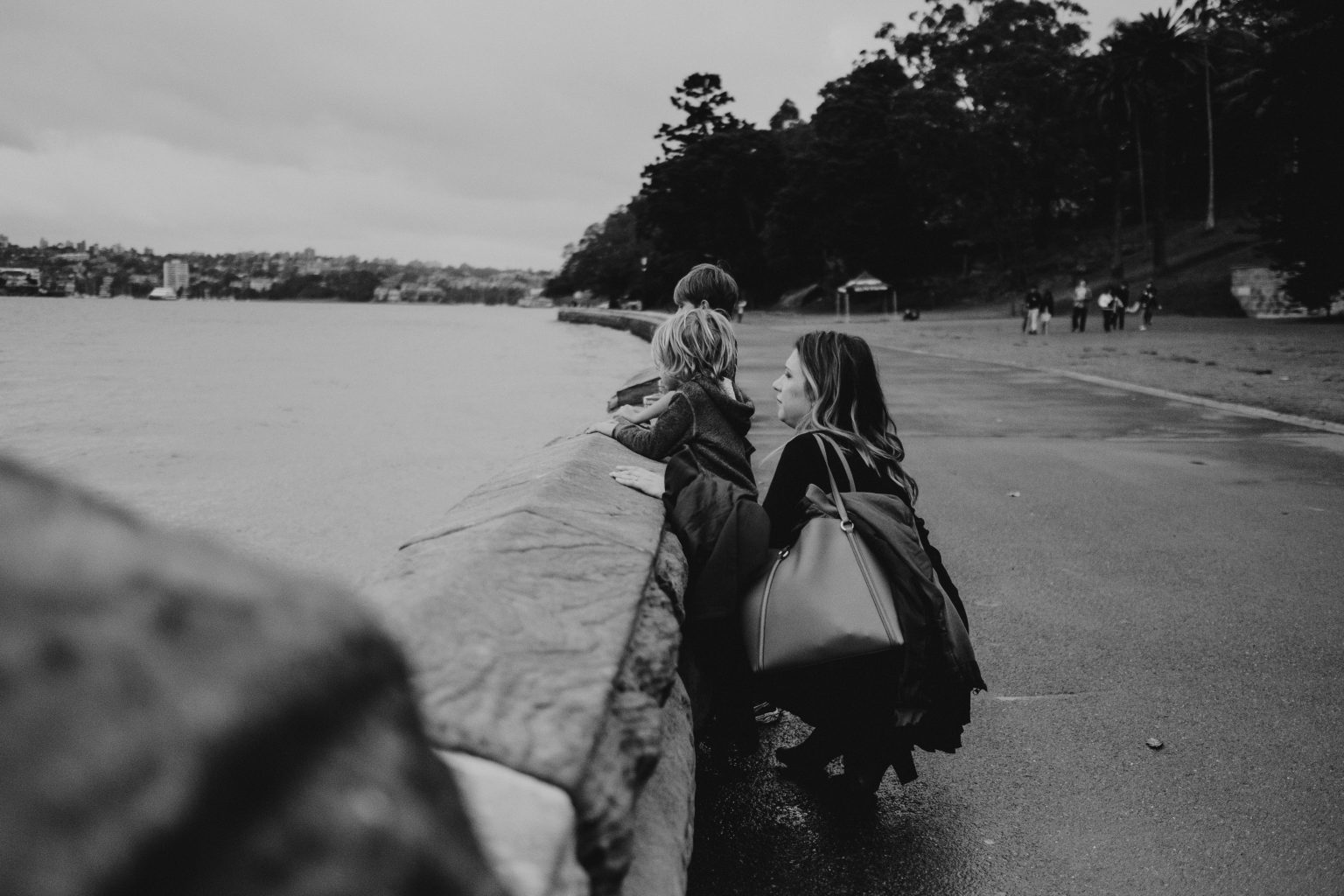 woman and children looking over Sydney harbour