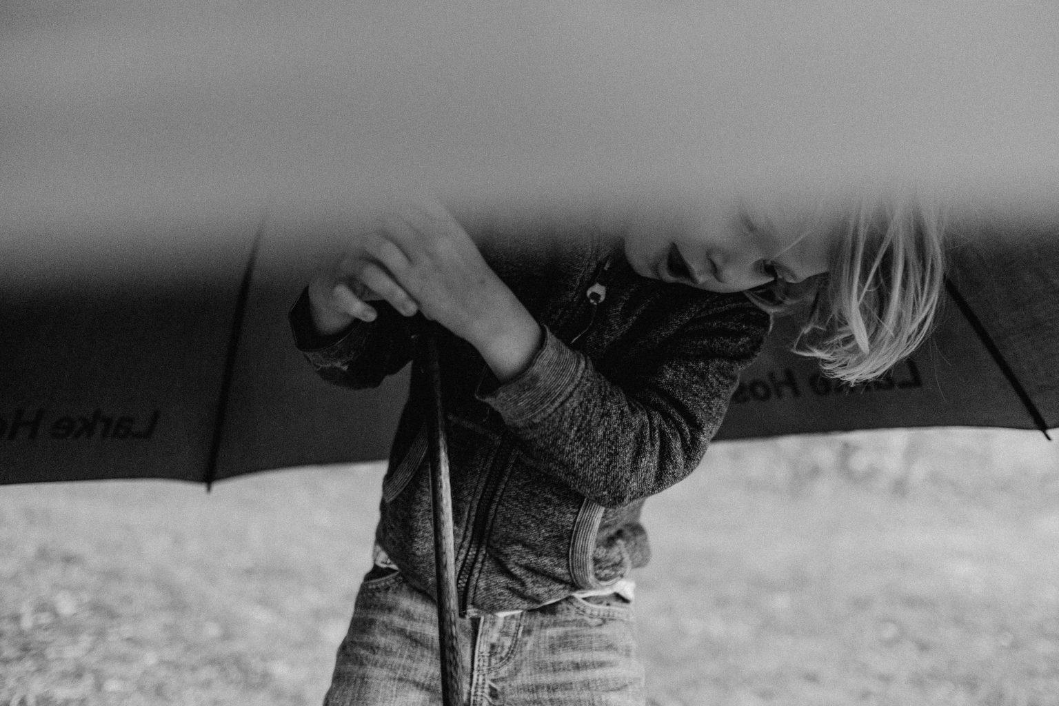 boy with umbrella Sydney harbour