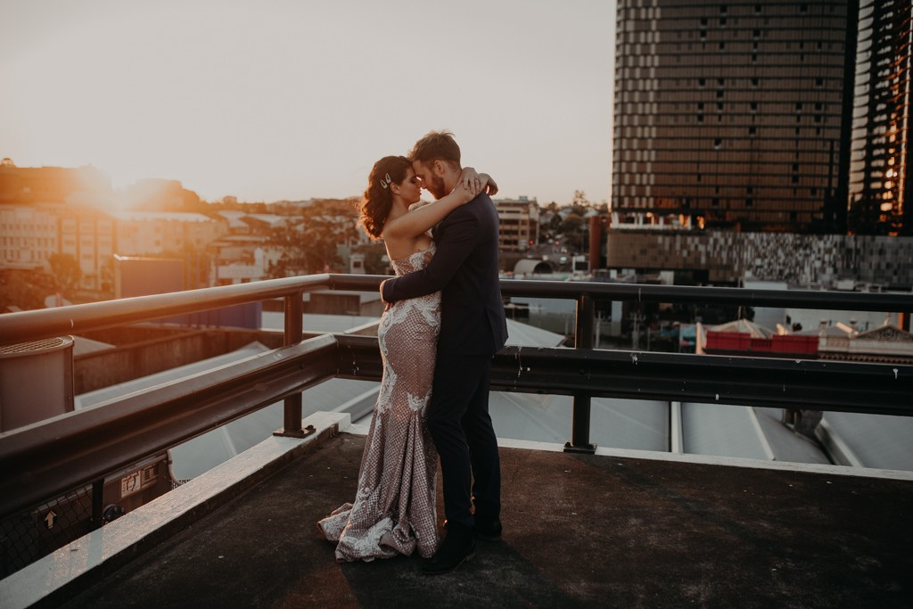 bride and groom dancing on rooftop for New York style elopement in Fortitude Valley Brisbane sunset