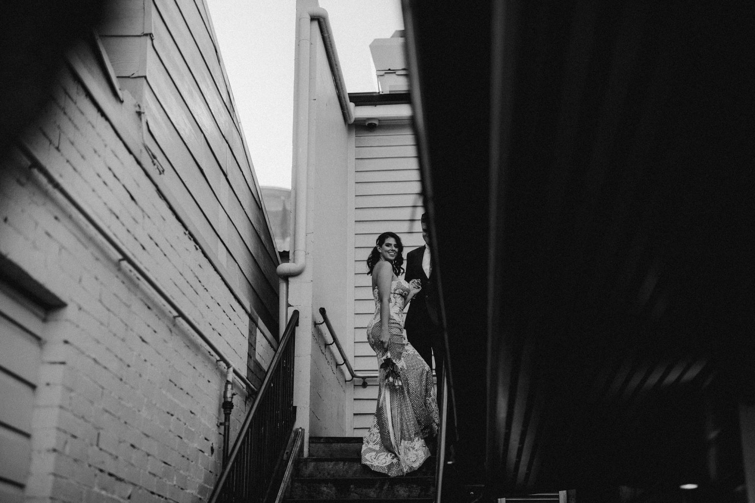bride and groom climbing stairs at Alfred and constance bar fortitude valley brisbane sexy