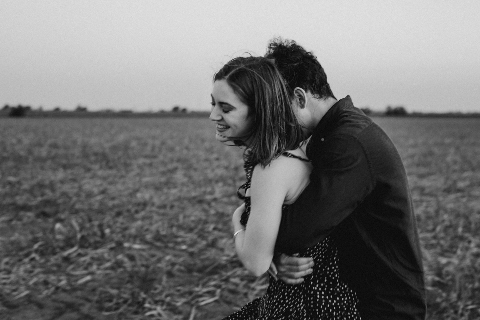 Man and woman hugging in field