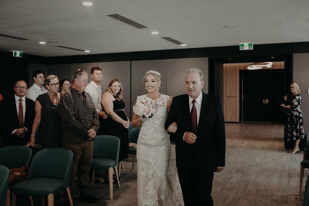 Bride walking down aisle with father at Brisbane Registry RBDM
