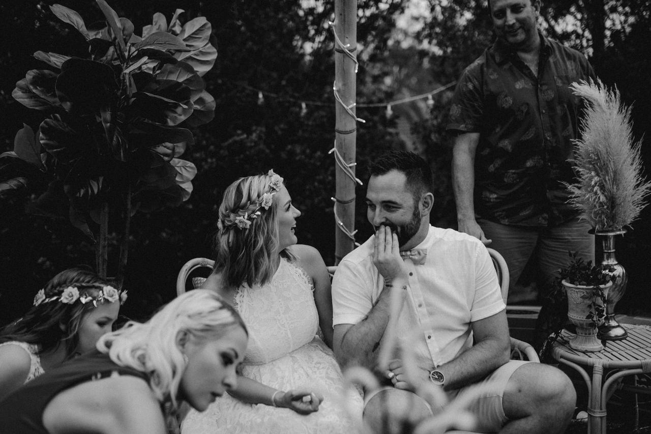 bride and groom talking  at garden wedding Eatons hill Brisbane