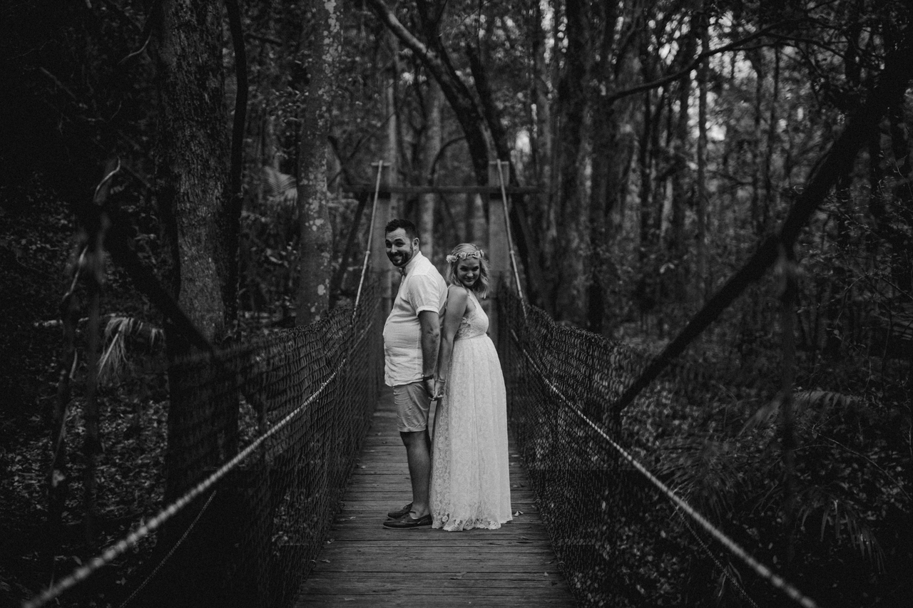 bride and groom on bridge  at Kumbartcho Sanctuary at Eatons Hill